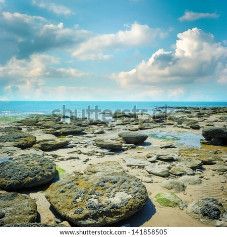 Rocky coast of northern France at summer day - stock photo