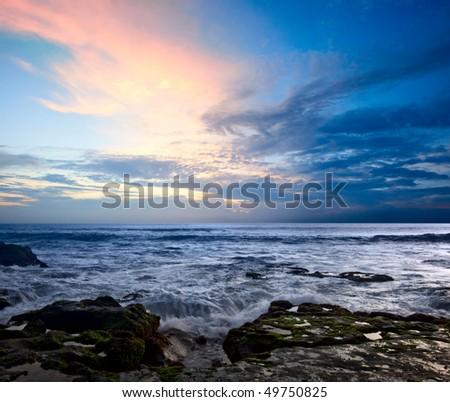 Rocky coast. Sunset - stock photo