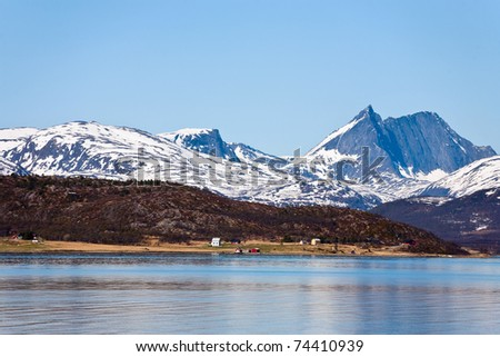 Rocky coastline in the horizon - stock photo