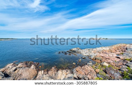 Rocky coastline in vivid colors during a beautiful summer day. Grisslehamn, Sweden - stock photo