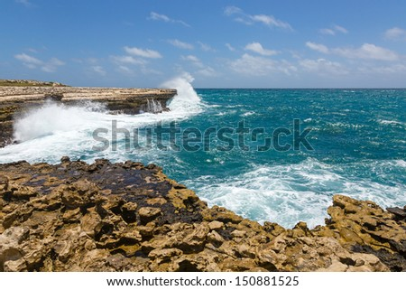 Rocky Coastline near Devil's Bridge Antigua in Sunshine - stock photo