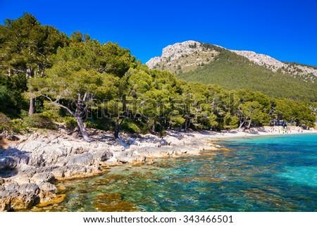 rocky coastline near the beach Cala Pi de La Posada, Mallorca, Spain - stock photo