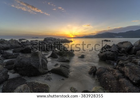Rocky coastline shot during sunset at Sungai Batu, Teluk Kumbar, Penang Malaysia