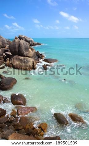 rocky coastline with beautiful  turquoise sea water - stock photo