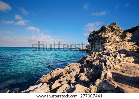 Rocky cove with ocean wave crashing into an eroded arch - stock photo