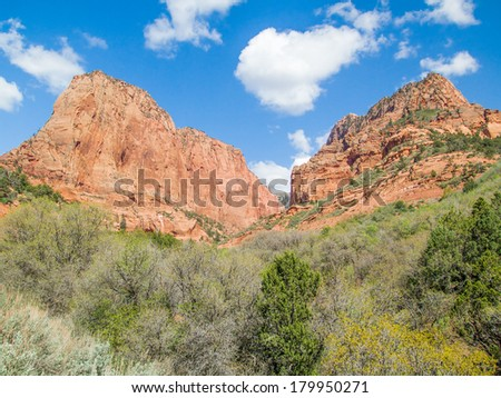 Rocky crags tower skyward in the Kolob Canyons District of Utah's Zion National Park. - stock photo