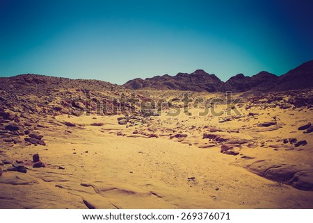 Rocky desert, the Sinai Peninsula, Egypt.  Filtered image:cross processed vintage effect.  - stock photo