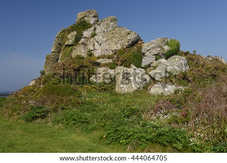 Rocky Granite Outcrop by the Beach of Old Grimsby on the Island of Tresco in the Isles of Scilly, England, UK - stock photo