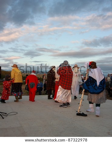 ROCKY HARBOUR, CANADA – JULY 16: Mummers dance on July 16, 2011 in Rocky Harbour, Newfoundland. The party was part of Parks Canada's 100th anniversary activities.