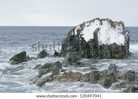 Rocky island in the Southern Ocean off the coast of Antarctica. - stock photo
