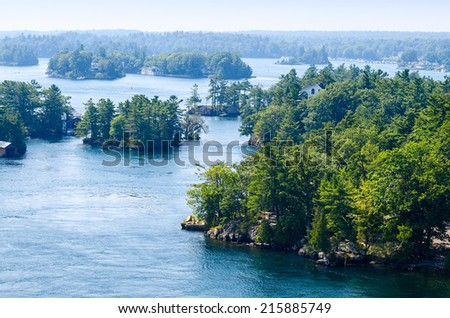 Rocky islands in the Thousand Islands region in Ontario - stock photo
