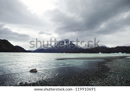 Rocky Lakeside with Mountains, Torres del Paine National Park - stock photo