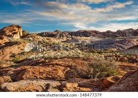 Rocky landscape in Valley of Fire at sunset - stock photo