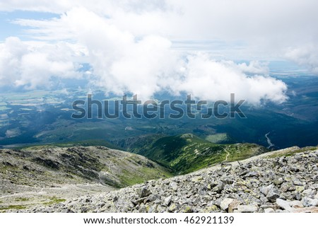 rocky mountain landscape covered with clouds and fog. High Tatra, Slovakia