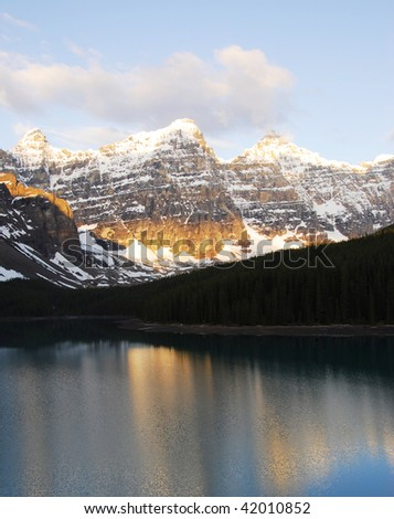 Rocky mountain peaks and moraine lake in spring, banff national park, alberta, canada - stock photo