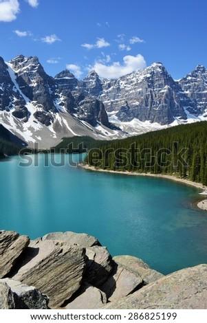 Rocky Mountain Range Curled Around Stunning Morraine Lake - stock photo