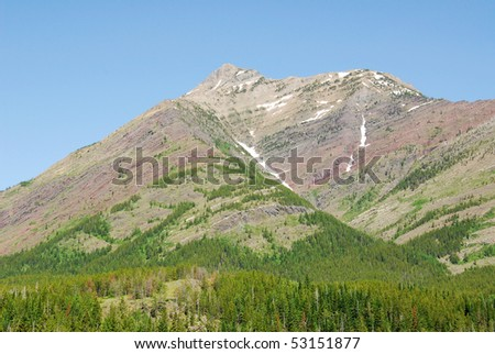 Rocky mountain ridge and forest in glacier national park, montana, usa - stock photo