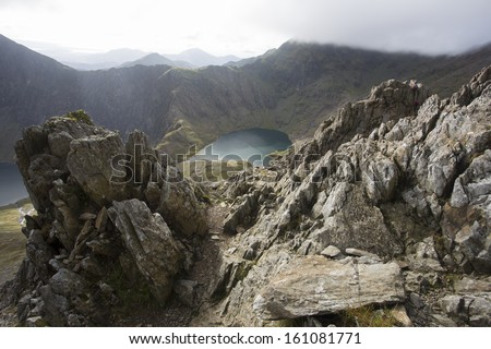 rocky mountain with lake in the valley, snowdon - stock photo