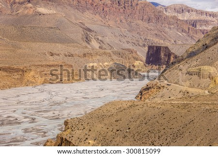 Rocky mountains and dry river,  Annapurna circuit, Himalaya, Nepal - stock photo