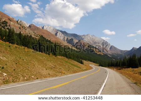 rocky mountains and road (highway 40) while traveling in kananaskis country, alberta, canada