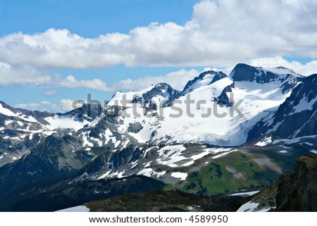 Rocky mountains at Whistler, Canada, home of the 2010 Winter Olympics. (View from Whistler mountain.) - stock photo