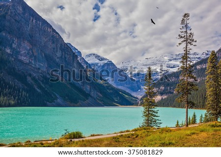 Rocky Mountains, Canada, Banff National Park. Magnificent Lake Louise with emerald water surrounded by glaciers. A great sunny day - stock photo