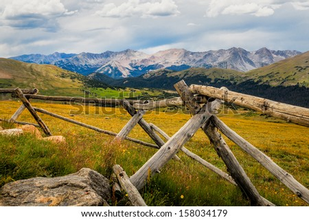 Rocky Mountains National Park, fence in the foreground with distant mountains - stock photo