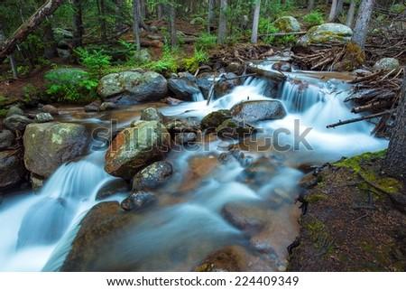 Rocky Mountains River. Small Mountain River Scenery. - stock photo