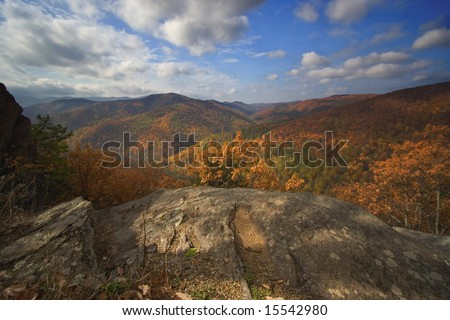Rocky overlook from mountain onto valley with fall colors - Blue Ridge Parkway, VA