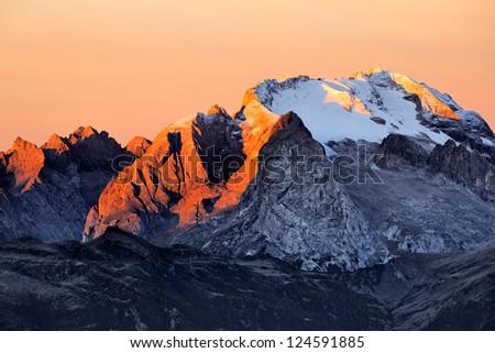 Rocky ridge with a glacier, Dolomites, Italy - stock photo