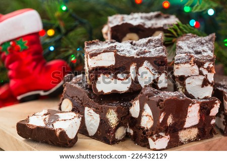 Rocky road crunch bars, christmas dessert made with chocolate,  marshmallow, hazelnut, biscuit and glace cherries - stock photo
