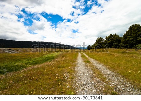 Rocky rural trail in New Zealand. - stock photo