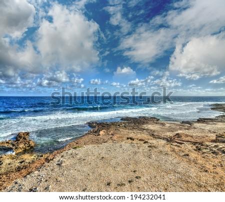 rocky shore in Argentiera, Sardinia - stock photo