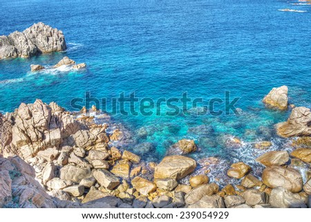rocky shore in Costa Paradiso, Sardinia. Processed for hdr tone mapping effect. - stock photo