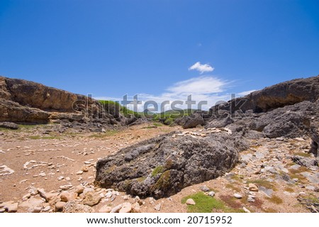 rocky shore inlet shete boca national park with view of cristoffel mountain curacao - stock photo