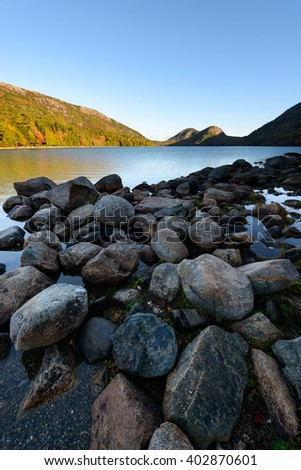 Rocky Shore of Jordan Pond at Sunrise - stock photo