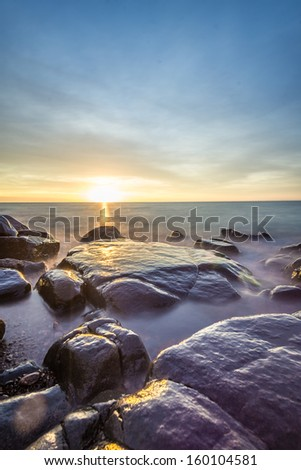 Rocky shore of Lake Superior during dusk time