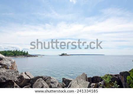 Rocky shore of Superior Lake at sunset - stock photo