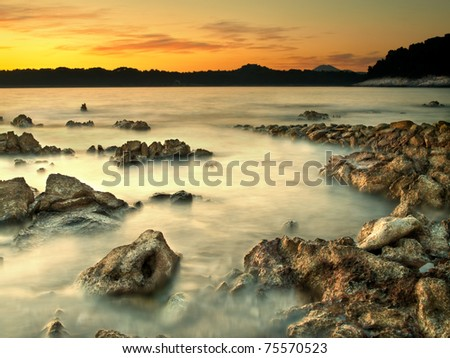 rocky shore  under the sunset light, Losinj island,Croatia,Adriatic sea,Europe,for backgrounds,nature,landscape themes - stock photo