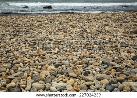 Rocky shore with sea in the distance - stock photo