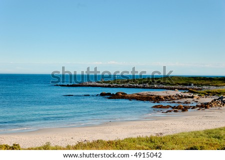Rocky shoreline along atlantic coast - stock photo