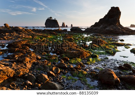 Rocky shoreline and and tide pools at sunset - stock photo