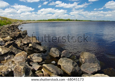 Rocky Shoreline:  Large boulders help to form a side of Petenwell Lake in central Wisconsin. - stock photo