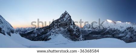 Rocky summit at sunrise panorama, Himalaya, Nepal - stock photo