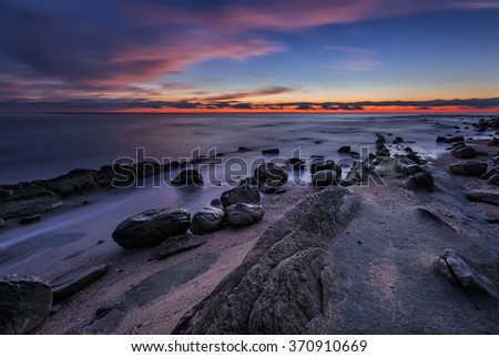 Rocky sunrise. Magnificent sunrise view in the blue hour at the Black sea coast, Bulgaria. - stock photo