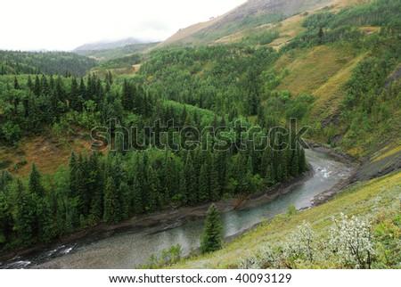 Rocky valley of sheep river in rain, Alberta, Canada - stock photo