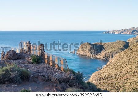 Rocky volcanic coastline  on Cabo de Gata natural park - stock photo