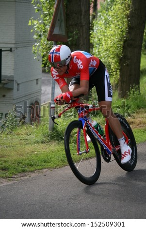 ROERMOND, HOLLAND - AUGUST 12 : Edvald boasson hagen From team SKY during time trial of Eneco cycling tour August 12, 2011 in Roermond, Holland.  - stock photo