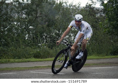 ROERMOND, HOLLAND - AUGUSTUS 12 : Proffesional cyclist  from team HTC High road  during time trial of Eneco cycling tour August 12, 2011 in Roermond, Holland.  - stock photo