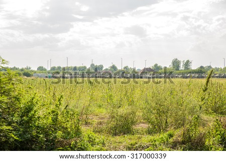 ROESZKE, HUNGARY - SEPTEMBER 15: A Refugee or Military camp related to the current Refugee crisis on the Serbian side on September 15, 2015 in Roeszke, Hungary.